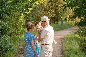 Grandparents and children walking