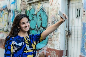 Latin woman making selfie.