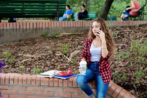 Young student girl with mobile phone