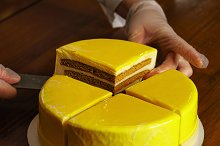 Confectioner cuts honey cake by  in Food & Drink