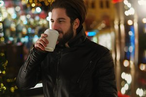 Guy with warming drink. Festive
