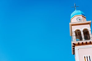 Church tower against blue sky on