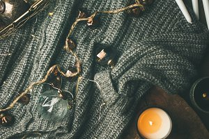 Woolen sweater, candles, garland and
