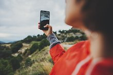 Young girl taking photo on cellphone by  in Holidays