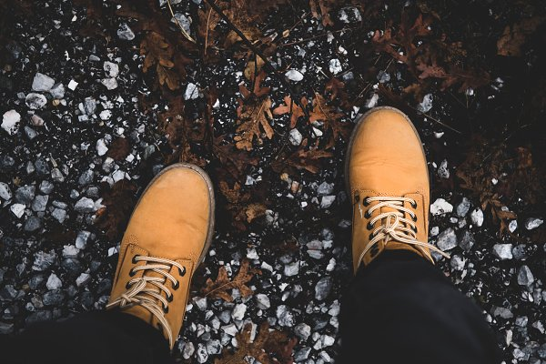 Feet of traveler in yellow boots