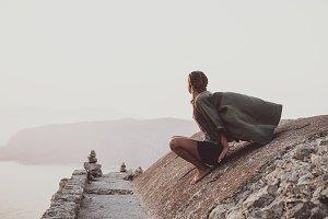Woman sitting and looking at horizon