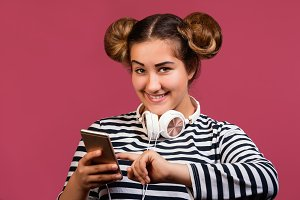 Teen girl use phone to listen music