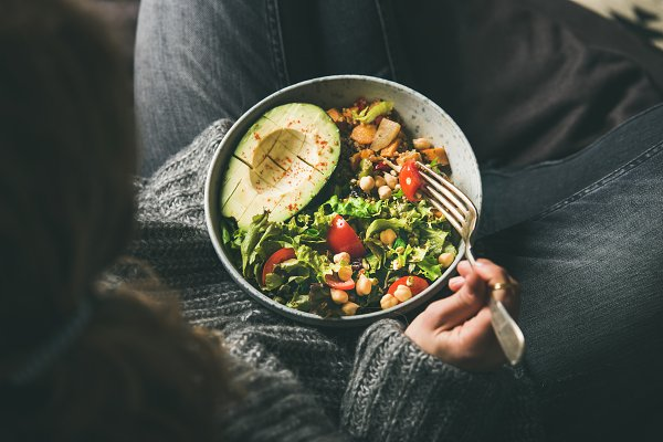 Woman holding bowl with healthy