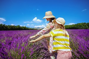 mother and child in lavender field t
