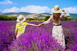 mother and daughter against lavender