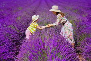 mother and daughter in lavender fiel