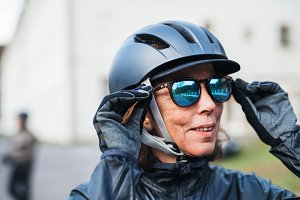 An active senior woman with bike