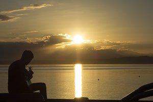 Man Playing Guitar Into Sunset