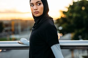 Fitness woman in hijab standing