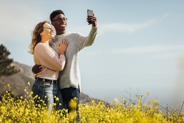 Loving young couple talking selfie
