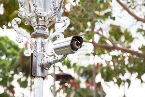 CCTV cameras on poles.