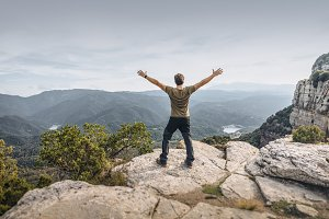 Man showing freedom in the mountain