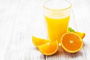 Glass of juice and orange fruits