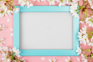 Turquoise springtime frame with blan
