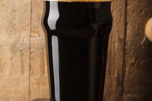 Pint of stout near a barrel