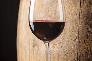 Red wine near a barrel