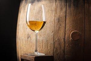 White wine near a barrel