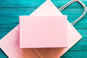 Pink gift box on shopping bag
