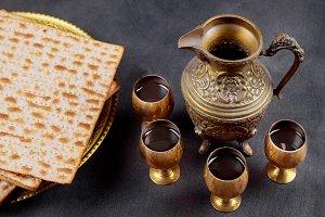 A Jewish Matzah bread with four glas