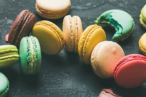 Colorful French macaroons over black