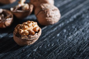 Whole walnuts and their kernels on a