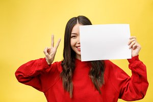 girl holds a white sheet in hands