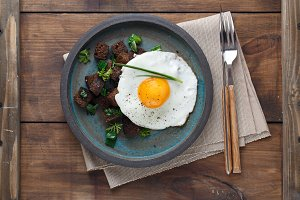 Sunny side fried egg with croutons