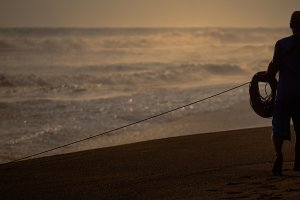 fisherman pulls net out ofocean
