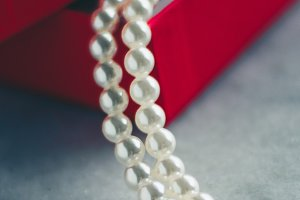 pearls in a red gift box