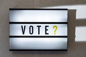 Message Vote on illuminated board. V