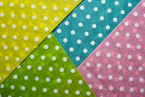 Multi Coloured background on dots. G