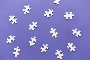 Pieces of jigsaw puzzle scattered