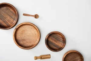 top view of wooden bowls, spoon and