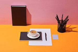 coffee cup, saucer, pen, paper sheet