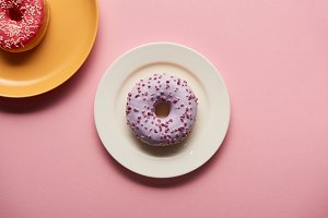 top view of tasty donuts on plates o