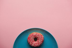 top view of tasty donut on blue plat