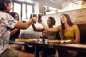 Multi-ethnic group of friends toast