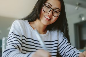 Smiling girl with eyeglasses