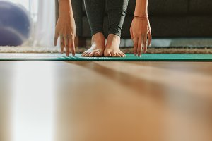 Girl's hands and feet during yoga