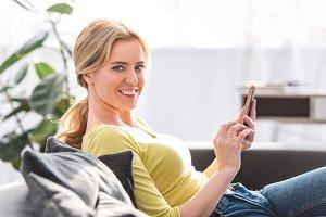 beautiful young woman using smartpho