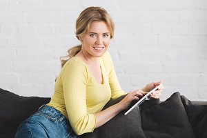 happy woman using digital tablet and