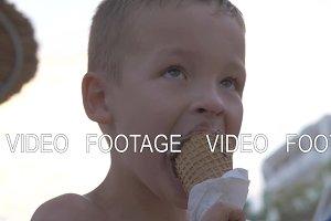 Kid enjoying chocolate ice cream