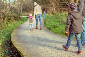 Family walking together holding hand