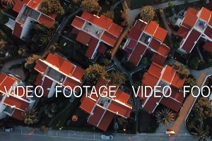 Aerial scene of villas and sea with
