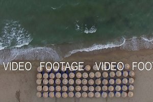 Empty sunbeds at the seaside, aerial
